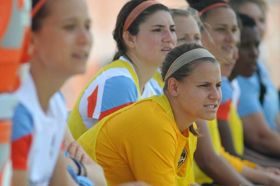 Megan Kinneman, center, a graduate of Elkins and LSU who is trying to make the Houston Dash, cheers on her prospective team during a scrimmage against Texas Tech. Photo: Jerry Baker, Freelance