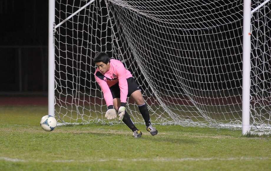 Langham Creek senior goalkeeper Jonathan Yanez (#1) made many saves during their 1-0 loss to Cypress Springs Friday 02/21/14. Photo: Â Tony Bullard 2014, Freelance Photographer / © Tony Bullard & the Houston Chronicle