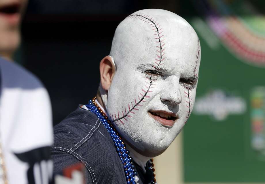 Balled head: When George Uhl leaves his seat at Comerica Park to buy a hot 