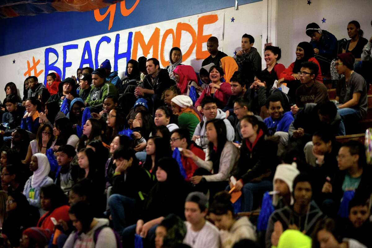 Students enjoy a pep rally for the Rainier Beach boys basketball team Monday, March 31, 2014, at Rainier Beach High School in Seattle. On April 2, the team will travel to New York to compete against other top teams from across the country in the DICK'S Sporting Goods National High School Tournament.