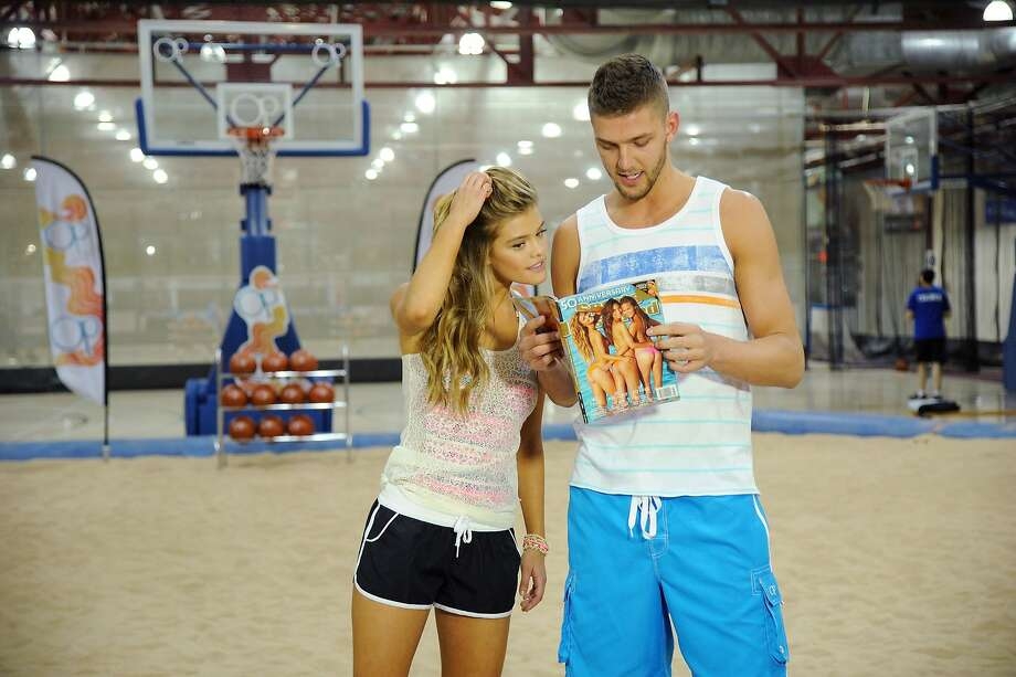 """Meanwhile, on the indoor beach ...The Houston Rockets' Chandler Parsons admires model Nina Agdal's work in the Sports Illustrated Swimsuit Issue during a photo shoot for OP in New York. Parsons is an """"ambassador"""" for the OP beach label. Photo: Bryan Bedder, Getty Images For Op"""