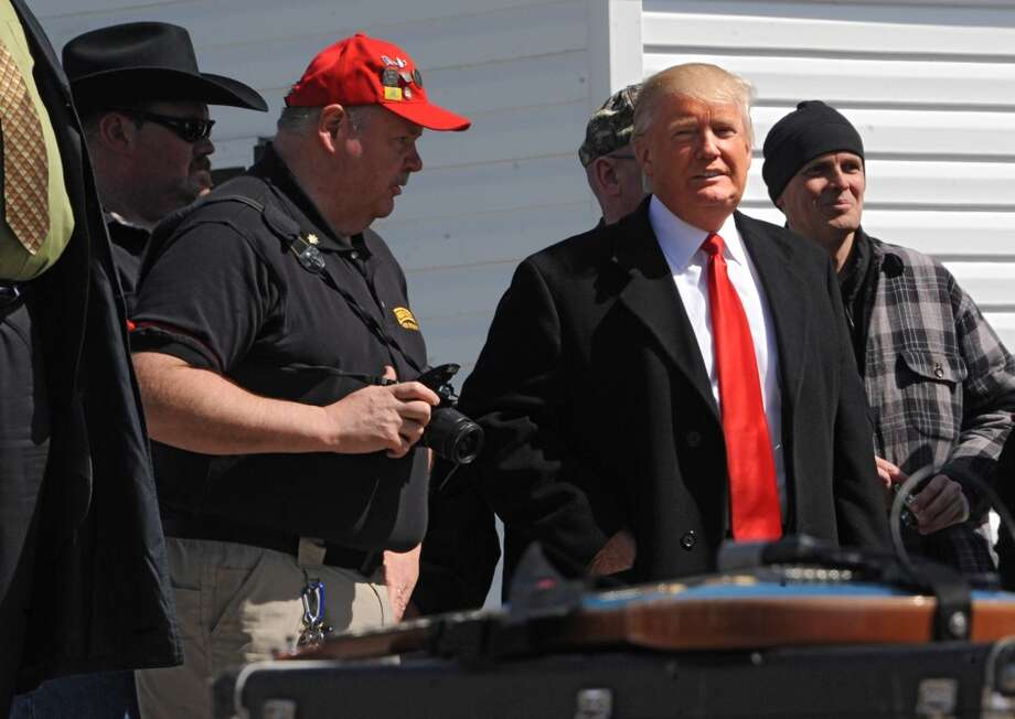 Donald Trump is seen on the side of the stage before he speaks to a crowd of second amendment advocates rallying against the NY SAFE Act at the Empire State Plaza Tuesday April 1, 2014 in Albany, N.Y. (Lori Van Buren / Times Union) Photo: Lori Van Buren, Albany Times Union