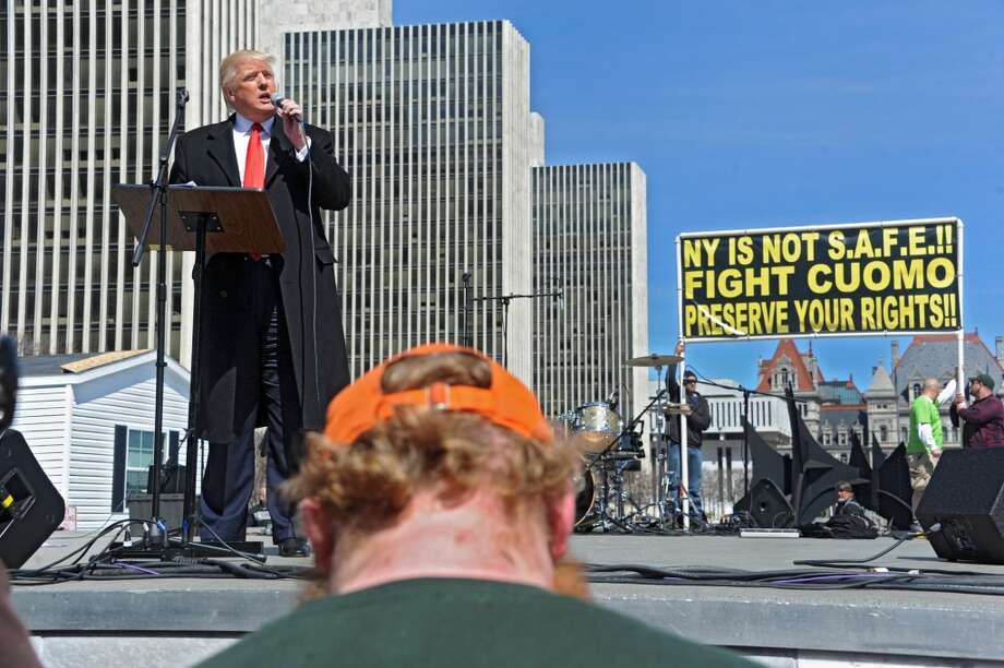 Donald Trump speaks to a crowd of second amendment advocates rallying against the NY SAFE Act at the Empire State Plaza Tuesday April 1, 2014 in Albany, N.Y. (Lori Van Buren / Times Union) Photo: Lori Van Buren, Albany Times Union