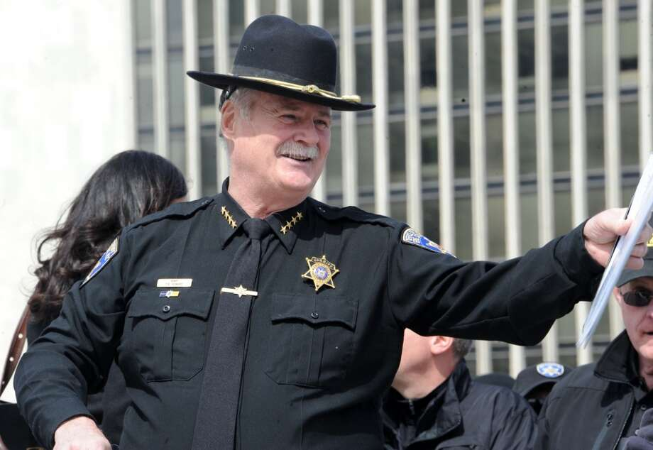 Erie County Sheriff Tim Howard speaks waits on the side of the stage to speak to a crowd of second amendment advocates rallying against the NY SAFE Act at the Empire State Plaza Tuesday April 1, 2014 in Albany, N.Y. (Lori Van Buren / Times Union) Photo: Lori Van Buren, Albany Times Union