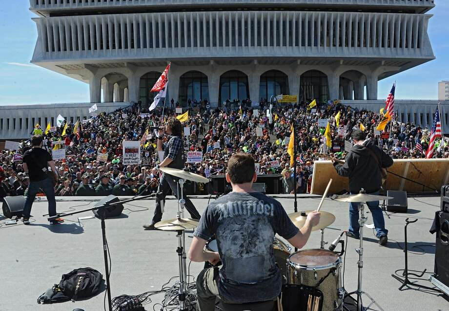 The patriotic rock group Madison Rising performs in front of a crowd of second amendment advocates rallying against the NY SAFE Act at the Empire State Plaza Tuesday April 1, 2014 in Albany, N.Y. (Lori Van Buren / Times Union) Photo: Lori Van Buren, Albany Times Union