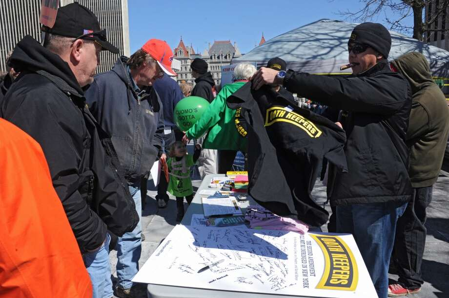 Vendors sell t-shirts as second amendment advocates rally against the NY SAFE Act at the Empire State Plaza Tuesday April 1, 2014 in Albany, N.Y. (Lori Van Buren / Times Union) Photo: Lori Van Buren, Albany Times Union
