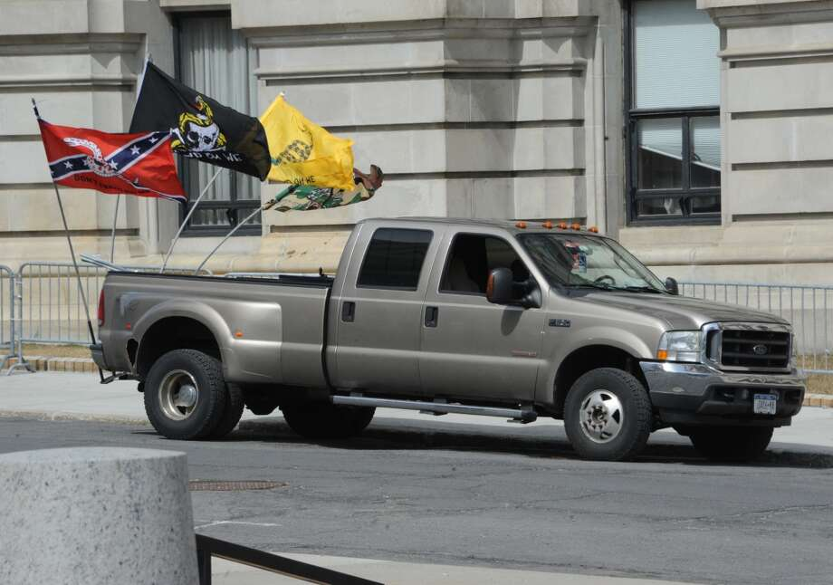 A truck with flags is seen parked outside the Capitol as second amendment advocates rally against the NY SAFE Act at the Empire State Plaza Tuesday April 1, 2014 in Albany, N.Y. (Lori Van Buren / Times Union) Photo: Lori Van Buren, Albany Times Union