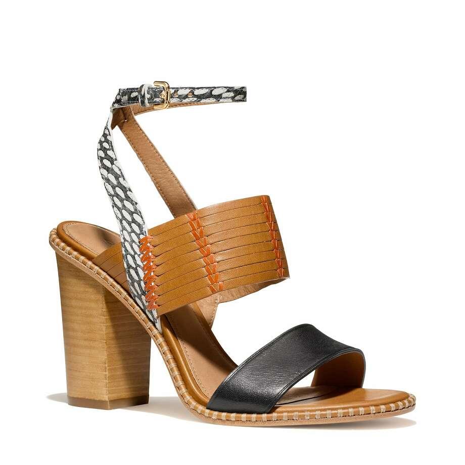 The Sevilla sandal sports a block heel and plenty of breezy boho attitude for summer weekend fun. $268, Coach stores. Photo: Courtesy Of Coach