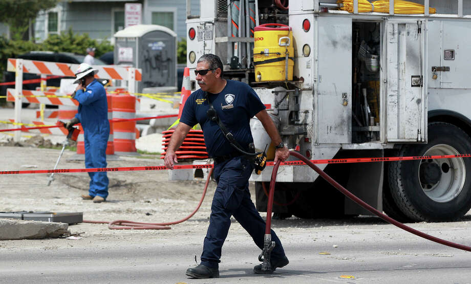City Public Service workers and San Antonio firefighters work Tuesday April 1, 2014 near the intersection of Basse and Blanco road after construction workers broke a two inch gas line. Six businesses in the area were evacuated and several blocks of Blanco road have been closed. San Antonio Fire Department spokesperson Christian Bove said the leak will take several hours to repair. Photo: JOHN DAVENPORT, SAN ANTONIO EXPRESS-NEWS / ©San Antonio Express-News/Photo may be sold to the public