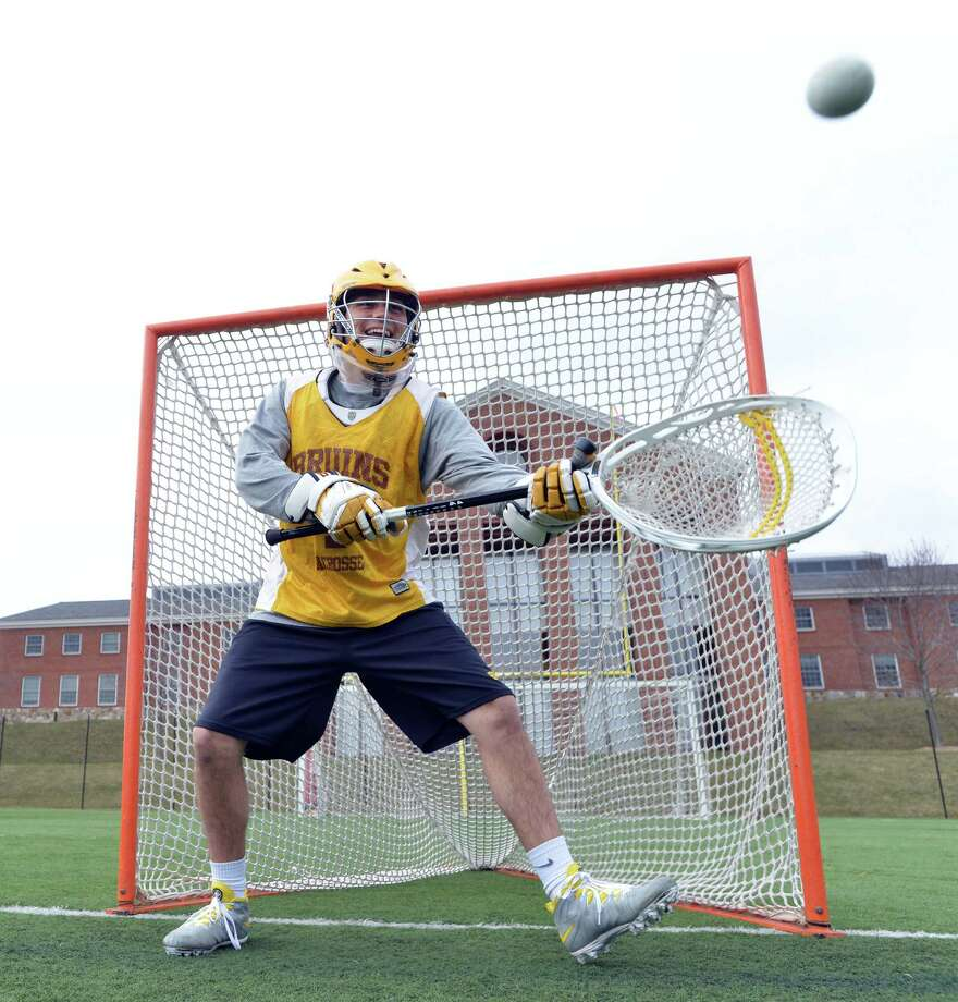 Brunswick School's Tommy Heidt, goalie, makes a stop during varsity lacrosse practice at the school in Greenwich, Conn., Tuesday, April 1, 2014. Photo: Bob Luckey / Greenwich Time