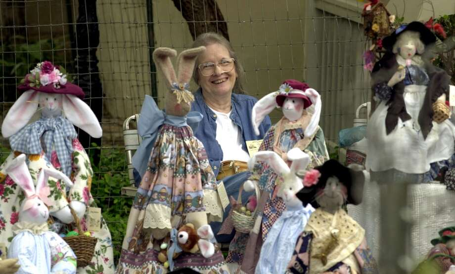 Carol Springs of Seguin waits for customers behind rows of Bag Babies at her Country Friends booth in 2000 duaring the Starving Artist Art Show at La Villita. Photo: Express-News, File