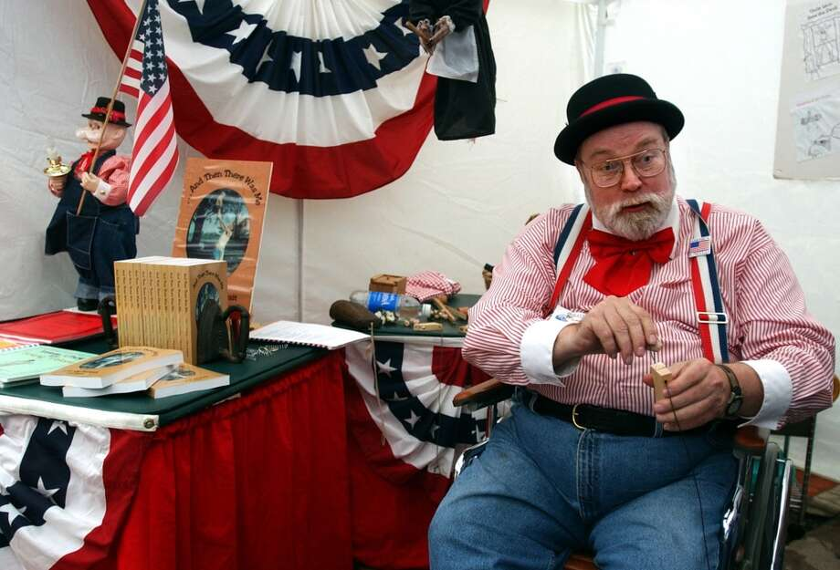 T. Brian Hudspeth works the Starving Artist Art Show in 2002. Photo: Express-News, File