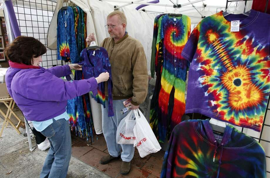 Jill Thorp (left) of Chicago assesses a tie dye shirt held by her brother Jim Thorp at the Starving Artist Art Show in 2007. Photo: J. Michael Short, Express-News