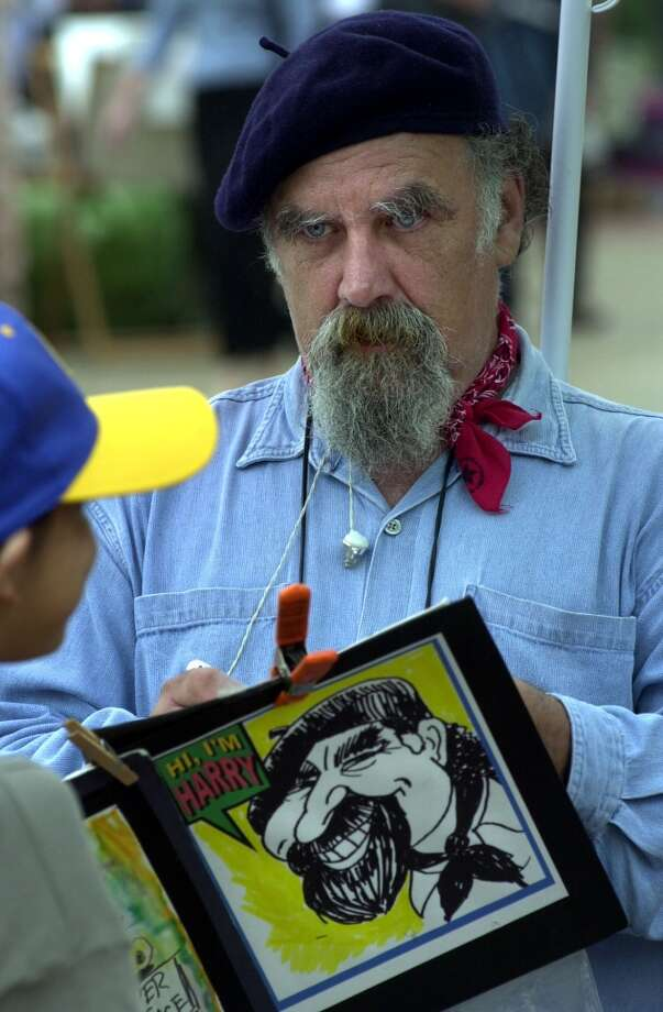 Harry Schneider creates a caricature of Valerie Garza (8) at the Starving Artist Art Show in 2000. Photo: Express-News, File
