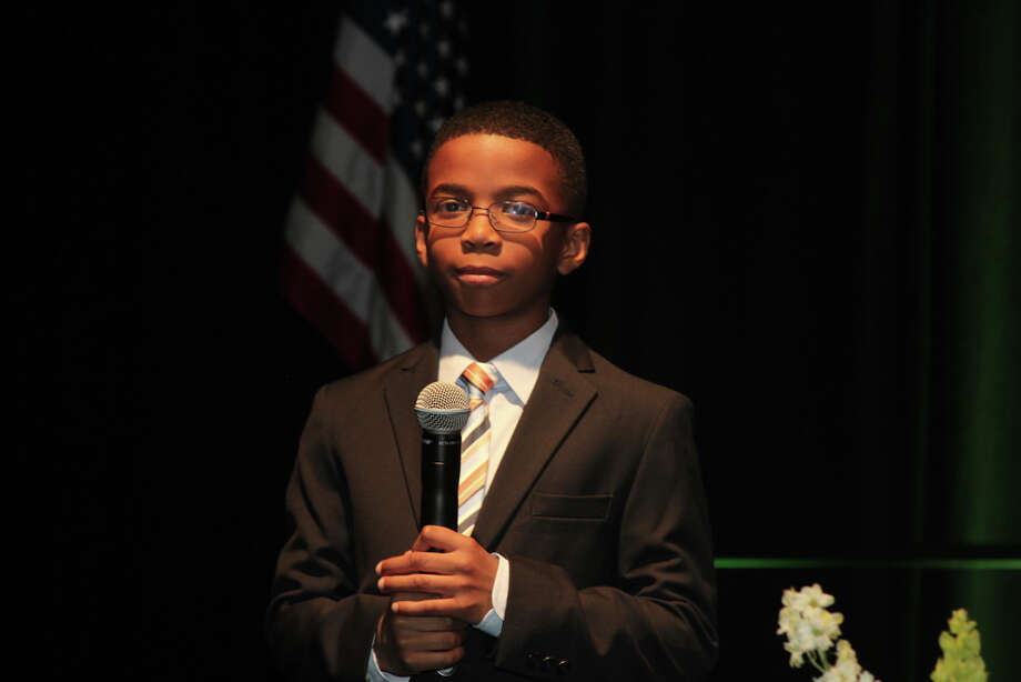 JA student Justin Washington (Fall Creek Elementary) preparing to sing the National Anthem at the Junior Achievement Awards celebration, March 27, 2014. Photo: Alton Ng