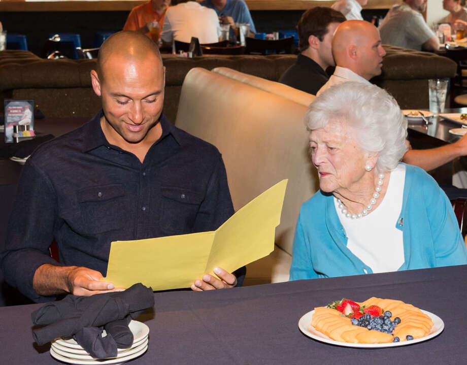 Derek Jeter and former First Lady Barbara Bush were seatmates April 2 at Clemens' Katch 22. Photo: John McCaine / John McCaine 2014