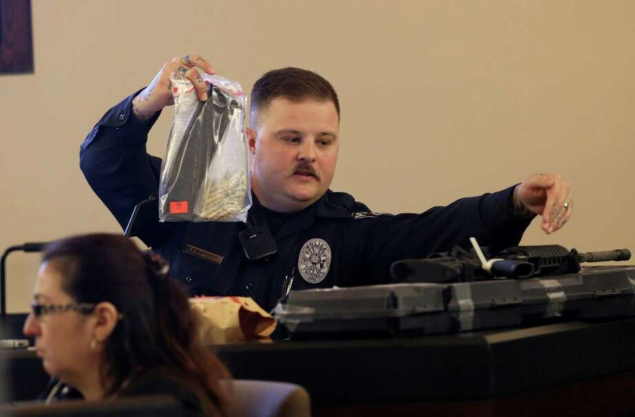 Windcrest police officer Tyler Lindsey testifies in the trial of Benjamin Blackstone on Tuesday April 1, 2014.  Blackstone was 18 when Windcrest police arrested him in April 2012 on charges of killing 22-year-old Jeffrey Keller with several blasts from a rifle. Photo: Helen L. Montoya, San Antonio Express-News / ©2013 San Antonio Express-News