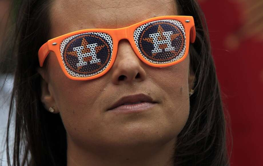 A woman wears Astros sunglasses at the 13th Annual Opening Day Street Festival on Crawford Street before the Astros game against the Yankees. Photo: Karen Warren, Houston Chronicle