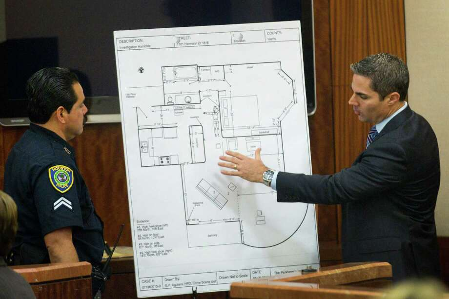 Houston police officer Ernest Aguilera, left, looks at an apartment diagram with prosecutor John Jordan during Ana Lilia Trujillo's trial, on Tuesday, April 1, 2014, in Houston. Photo: Brett Coomer, Houston Chronicle / © 2014 Houston Chronicle