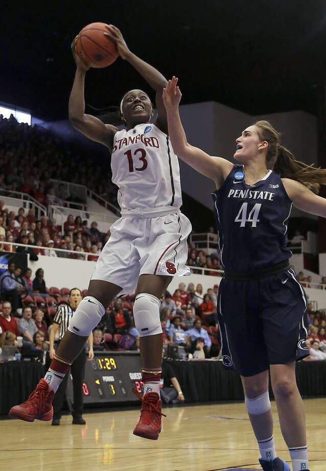 FILE - In this March 30, 2014 file photo, Stanford forward Chiney Ogwumike (13) shoots against Penn State forward/center Tori Waldner (44) during the first half of a regional semifinal game at the NCAA college basketball tournament in Stanford, Calif. Ogwumike was selected to The Associated Press women's basketball All-America team, released Tuesday, April 1, 2014. (AP Photo/Jeff Chiu, File) Photo: Jeff Chiu, Associated Press