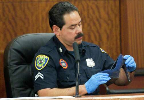 HPD officer Ernest Aguilera testifies about the stiletto shoe Tuesday, April 1, 2014, in Houston. Photo: Brett Coomer, Associated Press / Houston Chronicle