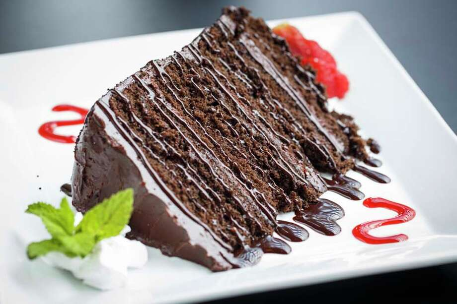"""Old School Chocolate Cake at Katch 22. Katch 22 is a joint venture between Luke Mandola Jr., whose father owns the Ragin' Cajun restaurants, and Kory Clemens, whose father is Roger """"The Rocket"""" Clemens. Photo: Michael Paulsen, Houston Chronicle / © 2013 Houston Chronicle"""