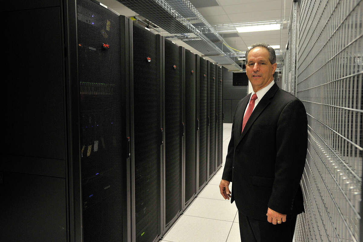 President and CEO Michael Boccardi poses next to a few of his customer's cabinets in the data center at Cervalis' data facility in Norwalk, Conn., on Tuesday, April 1, 2014. Cervalis provides IT infastructure solutions throughout its four data centers in the tri-state area, two of which are in lower Fairfield County.