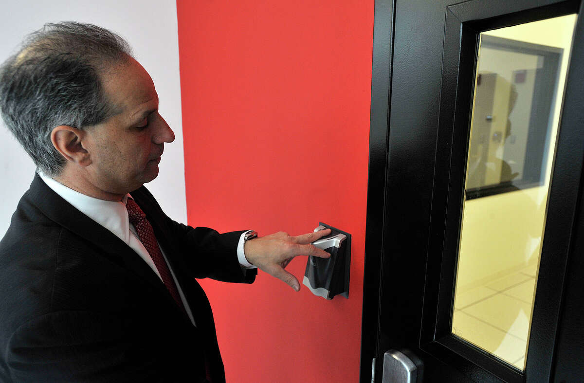 President and CEO Michael Boccardi uses a finger print identification system to enter a room at Cervalis' data facility in Norwalk, Conn., on Tuesday, April 1, 2014. Physical and information security is a big concern for Cervalis. Cervalis provides IT infastructure solutions throughout its four data centers in the tri-state area, two of which are in lower Fairfield County.