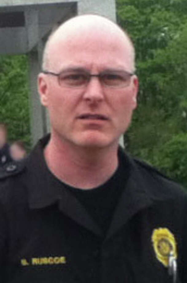 Trumbull police officer William Ruscoe, accused of sexually assaulting a teenaged girl he met through the Police Department's cadet program, was ordered by a judge Wednesday, March 5, 2104, not to leave the state. Ruscoe, who is charged with second, third and fourth-degree sexual assault and tampering with a witness, has been suspended from the Trumbull Police Department with pay. Photo: Contributed Photo / Connecticut Post