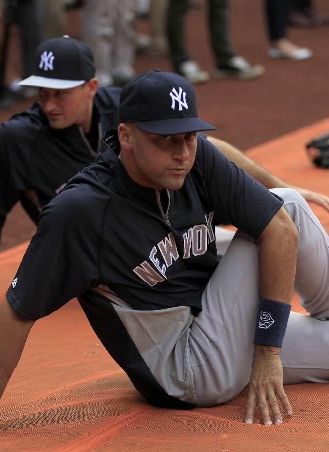 Yankees shortstop Derek Jeter stretches before the game. Photo: Karen Warren, Houston Chronicle