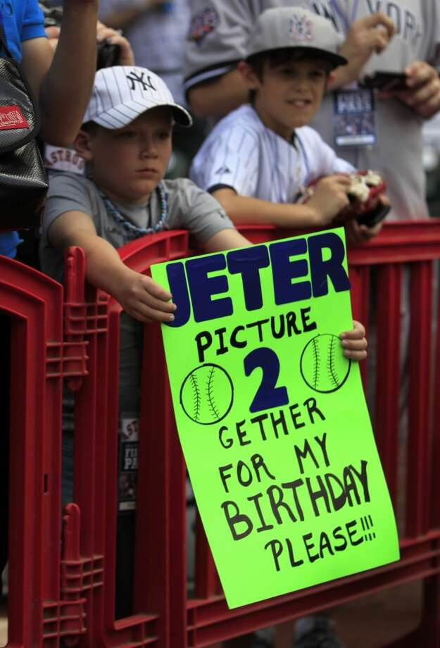 Landon Bailey, 9, of Vidor, holds a sign for New York Yankees shortstop Derek Jeter before the start of the game. Photo: Karen Warren, Houston Chronicle