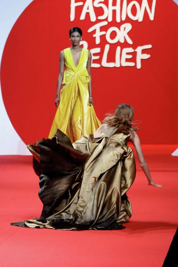 A model falls while walking down the runway at the Fashion For Relief at Forville market during the 64th Annual Cannes Film Festival on May 16, 2011 in Cannes, France. Photo: Vittorio Zunino Celotto, Getty Images / 2011 Getty Images