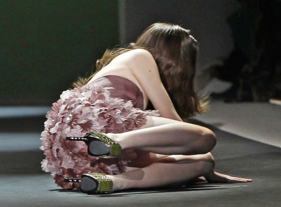 In this Feb. 10, 2011 file photo, a model falls to the runway during the Christian Siriano Fall 2011 show during Fashion Week in New York. Photo: Associated Press / AP2011