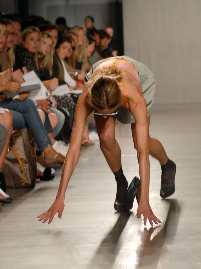 In this Sept. 11, 2006 file photo, a model trips and falls during the Proenza Schouler spring 2007 runway show during Fashion Week in New York. Photo: Paul Hawthorne, Associated Press / AP2006