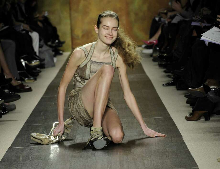 In this Feb. 15, 2009 file photo, a model falls down on the runway while modeling the fall 2009 collection of Herve Leger by Max Azria during Fashion Week in New York. Photo: Louis Lanzano, Associated Press / AP2009