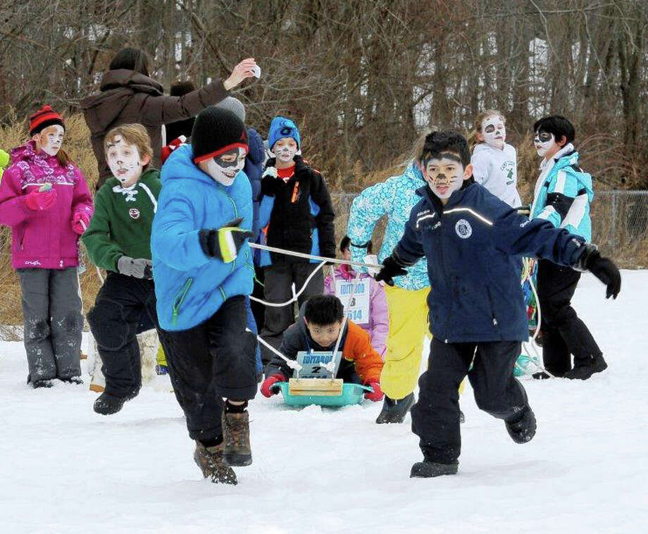 East Elementary School students in Thomas Dempseyís third-grade class participated in a mini Iditarod race around the school grounds on March 7, 2014. Photo: Contributed Photo, Contributed / New Canaan News Contributed