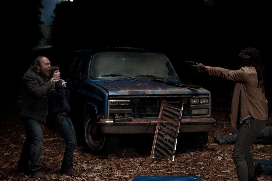 Keith Brooks, Carl Grimes (Chandler Riggs) and Michonne (Danai Gurira) - The Walking Dead _ Season 4, Episode 16 - Photo Credit: Gene Page/AMC Photo: Gene Page/AMC
