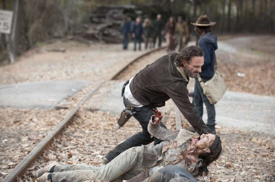 Rick Grimes (Andrew Lincoln) and Carl Grimes (Chandler Riggs) - The Walking Dead _ Season 4, Episode 16 - Photo Credit: Gene Page/AMC