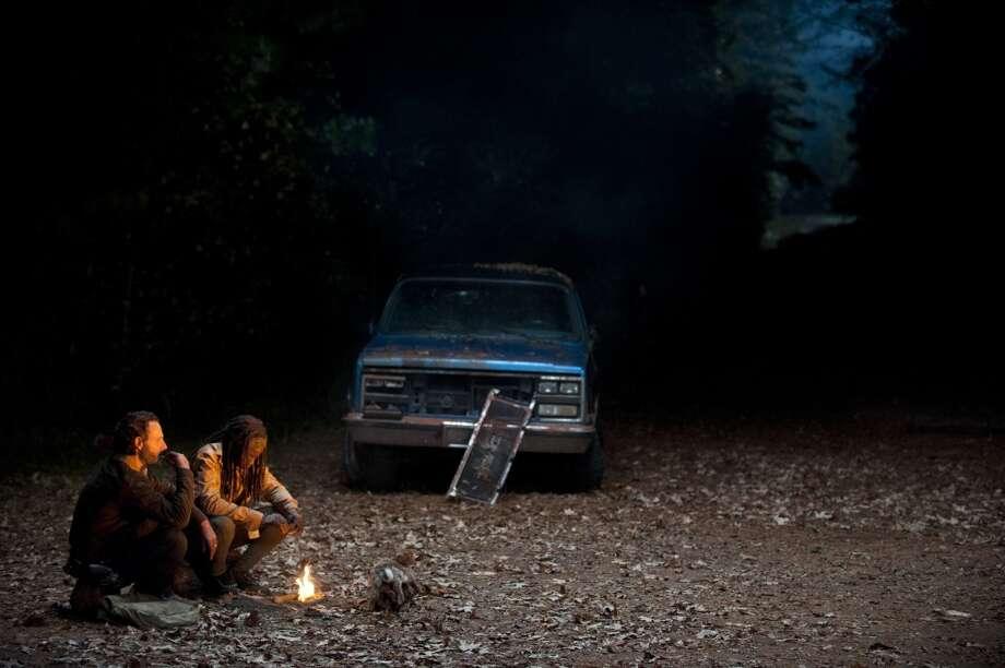 Rick Grimes (Andrew Lincoln) and Michonne (Danai Gurira) - The Walking Dead _ Season 4, Episode 16 - Photo Credit: Gene Page/AMC Photo: Gene Page/AMC