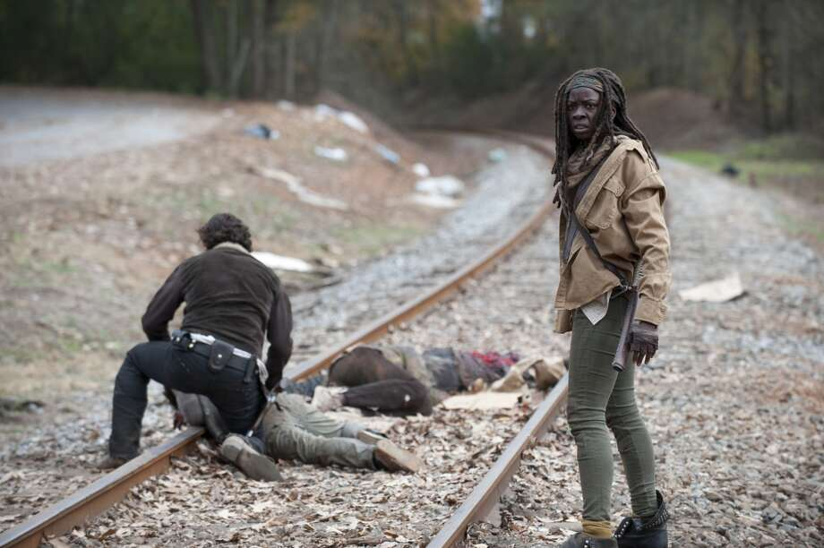 Rick Grimes (Andrew Lincoln) and Michonne (Danai Gurira) - The Walking Dead _ Season 4, Episode 16 - Photo Credit: Gene Page/AMC