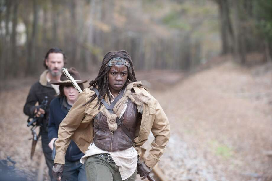 Rick Grimes (Andrew Lincoln) and Michonne (Danai Gurira) - The Walking Dead _ Season 4, Episode 16 - Photo Credit: Gene Page/AMC Photo: Gene Page/AMC