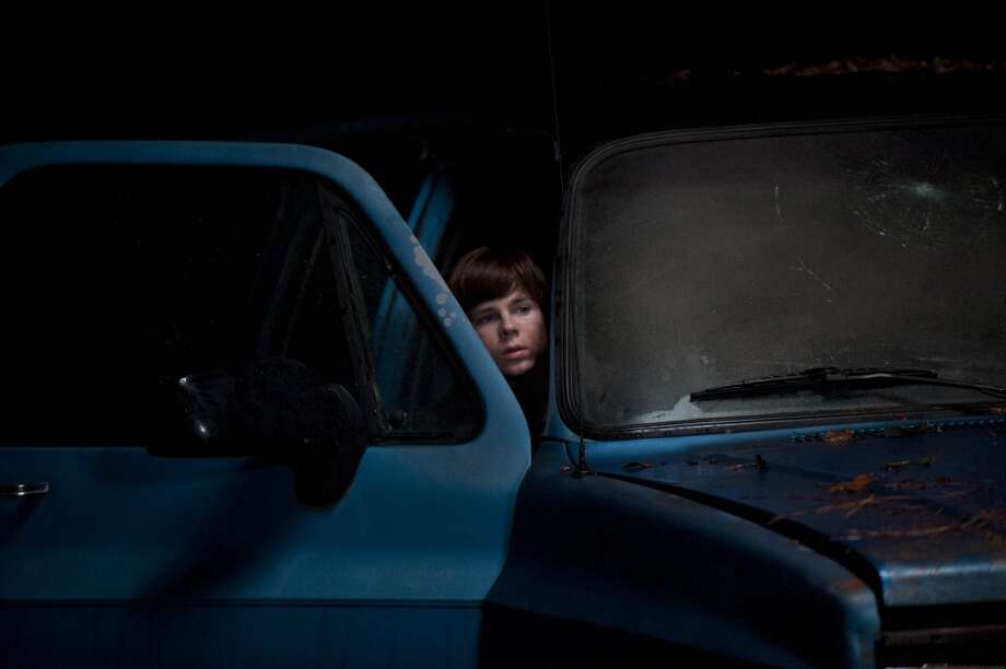 Carl Grimes (Chandler Riggs) - The Walking Dead _ Season 4, Episode 16 - Photo Credit: Gene Page/AMC Photo: Gene Page/AMC