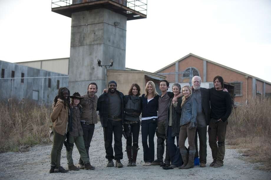 Danai Gurira, Chandler Riggs, Andrew Lincoln, Chad Coleman, Lauren Cohan, Denise Huth, Steven Yeun, Melissa Suzanne McBride, Emily Kinney, Scott Wilson and Norman Reedus - The Walking Dead _ BTS - Season 4, Episode 16 - Photo Credit: Gene Page/AMC Photo: Gene Page/AMC