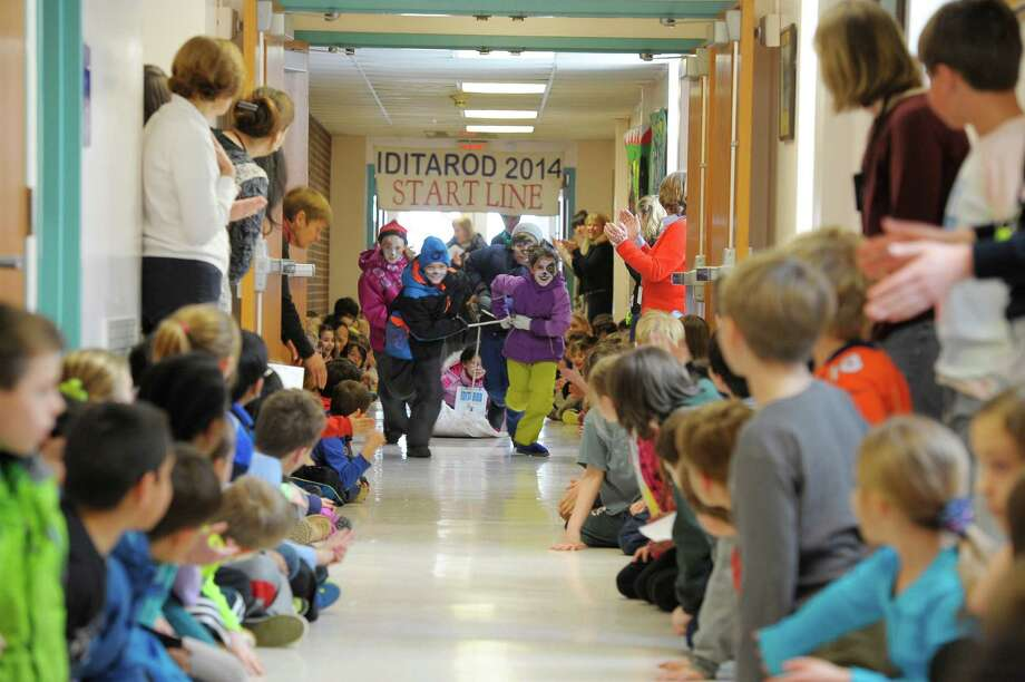 East Elementary School students in Thomas DempseyâÄôs third-grade class participated in a mini Iditarod race around the school grounds on March 7, 2014. Photo: Contributed Photo, Contributed / New Canaan News Contributed