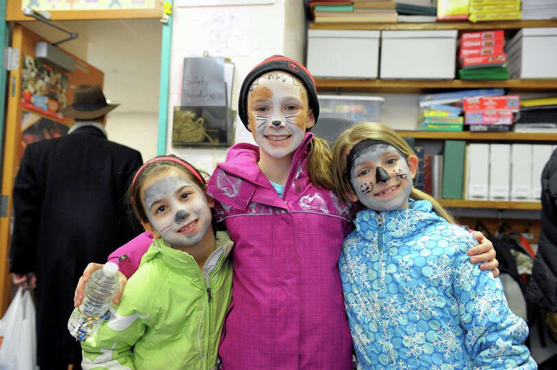 East Elementary School third-graders Lexi Hirai, Polly Parsons and Sydney Lanxon dressed up as sled