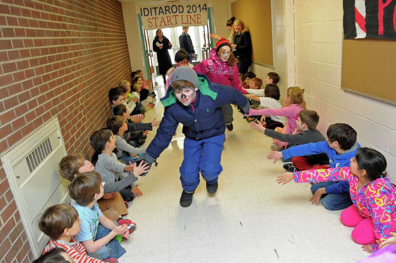 Third-graders Alex Holtzapffel and Polly Parsons participated in a mini Iditarod at East Elementary