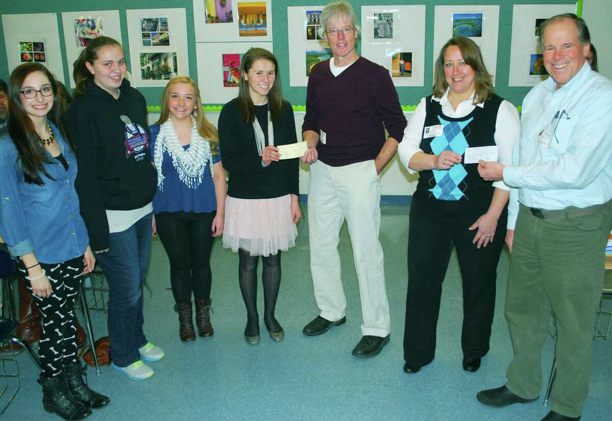 The New Milford River Trail Alliance recently received a donation from the New Milford High School Interact Club and the Rotary Club of New Milford toward the purchase of a bike rack to be placed in town. Above, from left to right, Interact Club treasurer Nicole Callisen, secretary Ashley Loser, vice president Tiana Lungo and president Emily Day present the clubâÄôs portion of the donation to Tom OâÄôBrien, the alliance chairman, as Lisa Arasim, treasurer of the alliance, receives a portion of the donation from Dr. Peter Daubner, the Rotary ClubâÄôs advisor to the Interact Club. Courtesy of New Milford High School