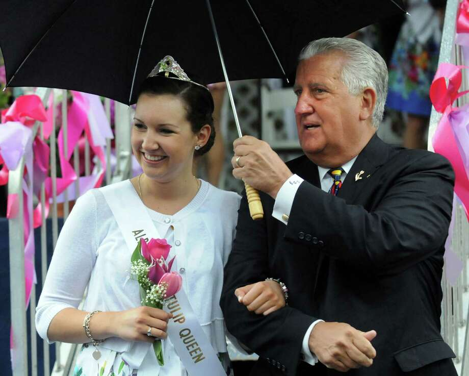 Mayor Jerry Jennings escorts Tulip Queen Kate Bender, 18, of Slingerlands following the coronation during the Tulip Festival on Saturday, May 11, 2013, at Washington Park in Albany, N.Y. (Cindy Schultz / Times Union) Photo: Cindy Schultz / 00022344A