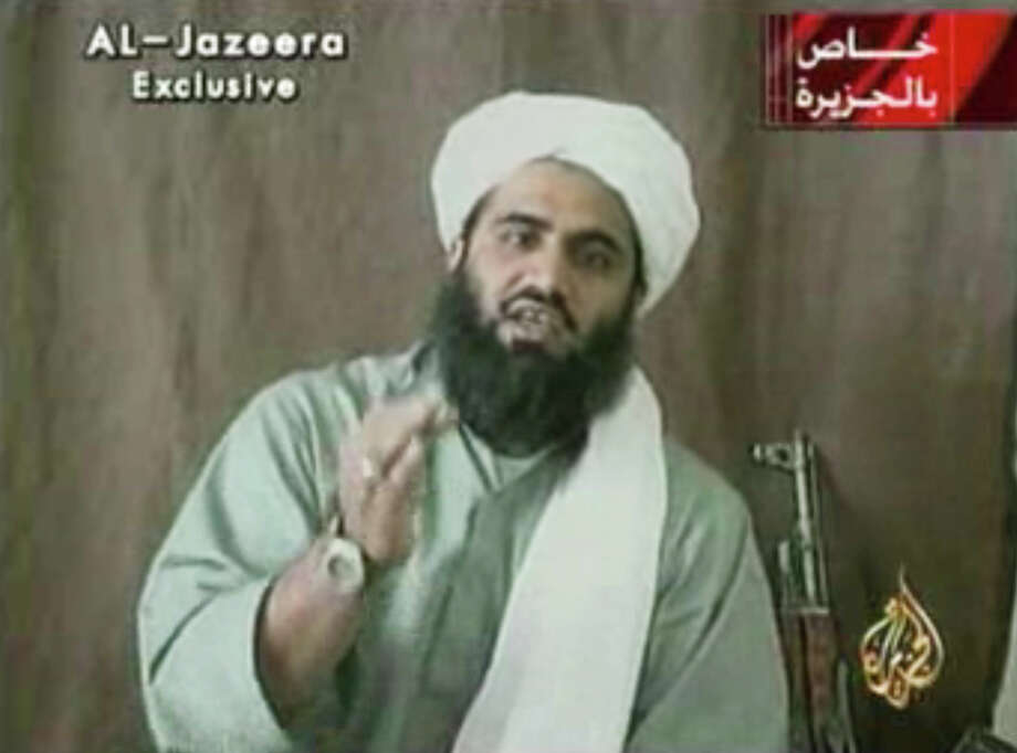 FILE - In this undated image made from video and provided by by Al-Jazeera, Sulaiman Abu Ghaith, is shown.  Osama bin Laden's son-in-law and spokesman still maintains that there was justification for the September 11, 2001 attacks orchestrated by al-Qaida upon the United States. Sulaiman Abu Ghaith, who is being tried in a New York City courtroom for conspiring to kill Americans, is using courtroom theater, intentionally or not, to press his case that the United States is such a bully in the Middle East that even killing civilians was justified. (AP Photo/Al-Jazeera, File) Photo: Uncredited, TEL / Al-Jazeera