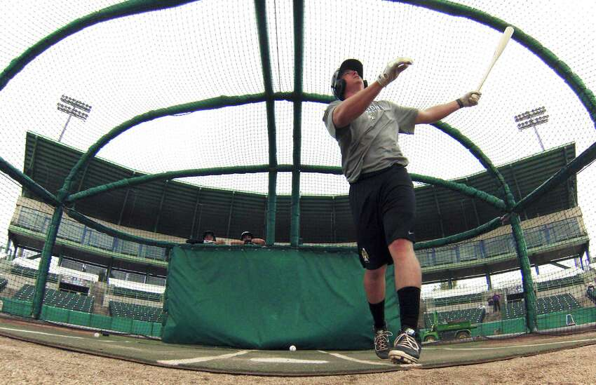 Lee Orr of the San Antonio Missions watching the ball fly as he hits in the batting cage during the first workout for the team at Wolff Stadium on Tuesday, April 1, 2014.